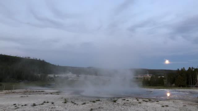 castle geyser eruption under full moonlight - vollmond stock-videos und b-roll-filmmaterial