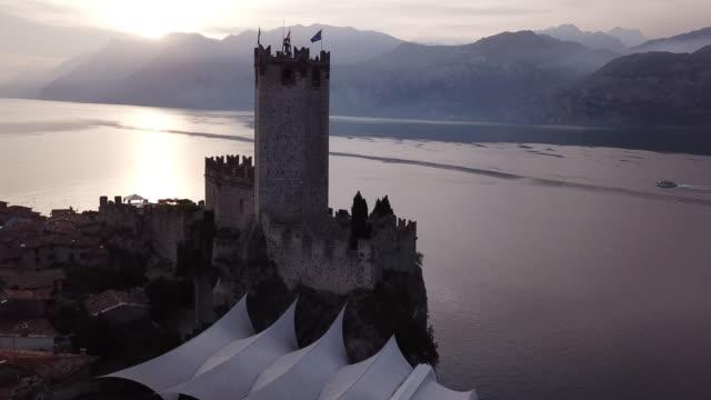 castle on lake garda, aerial - loch stock videos & royalty-free footage