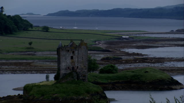 castle stalker occupies a small grassy island in scotland. available in hd. - castle island stock videos & royalty-free footage