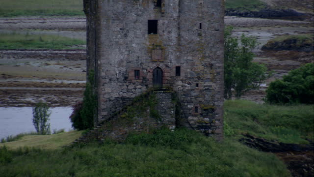 castle stalker rests on an inlet in loch laich. available in hd. - inlet stock videos & royalty-free footage