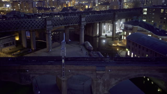 castlefield, manchester, at night. including, trains, bridgewater canal, bridges. drone. - canal stock videos & royalty-free footage
