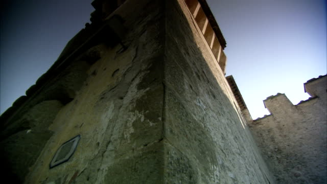 A castle's tall tower is surrounded by crenellations. Available in HD.