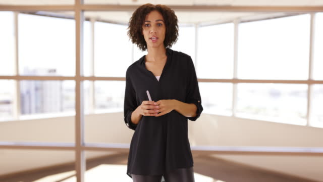 casual black woman standing teaching speech.  black female teacher videochats on camera. - african american culture stock videos & royalty-free footage