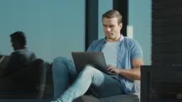 Casual businessman closing notebook. Closeup modern man working on laptop