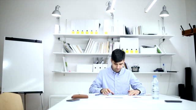casual man working on documents - teleworking stock videos and b-roll footage
