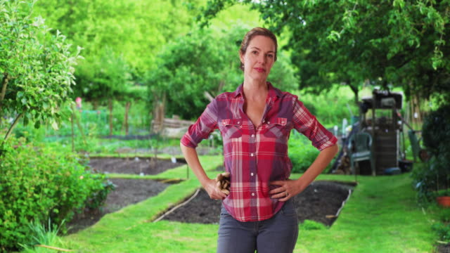 casual portrait of smiling woman farmer with gloves - gardening glove stock videos & royalty-free footage