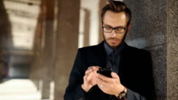Casual urban professional businessman using smartphone
