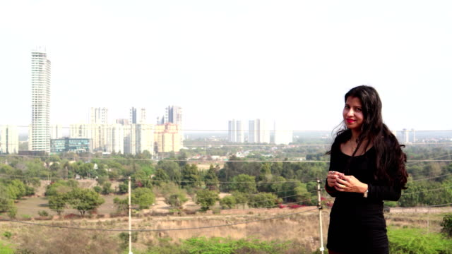 casual young women standing near city buildings - haryana stock videos & royalty-free footage