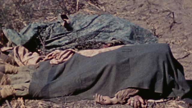 tu casualties covered by blankets and wrecked lvt they were pulled from / iwo jima japan - schlacht um iwojima stock-videos und b-roll-filmmaterial
