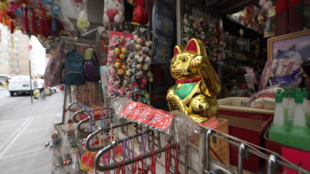 cat toy waving in chinatown - chinatown stock videos & royalty-free footage