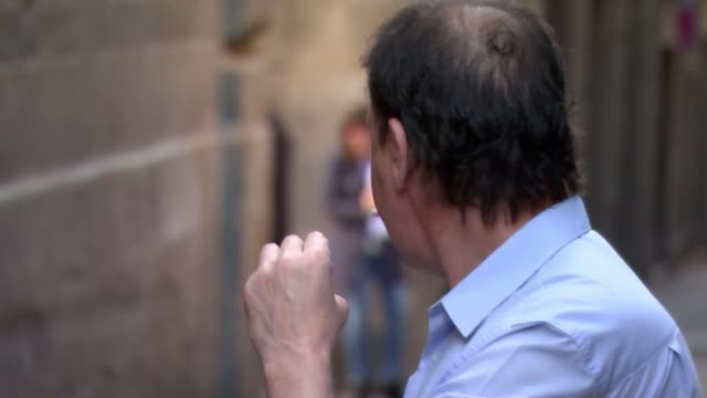 vídeos y material grabado en eventos de stock de separatist leader carles puigdemont flees to belgium spain catalonia barcelona ext people in square outside catalan presidency palace as bells... - cigarrillo