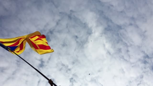 A Catalan flag is waved on October 2 Barcelona Spain The Catalonian referendum vote took place on October 1 2017 in Barcelona Spain According to...