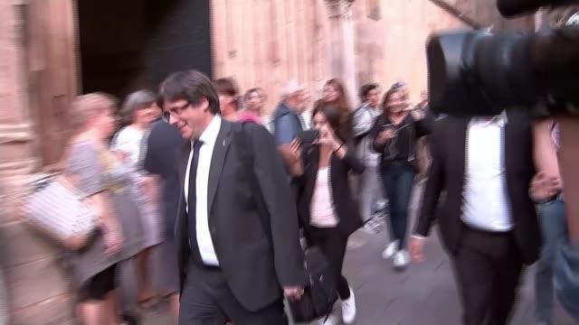 President backs down from snap election Puigdemont towards as along to Parliament followed by press and ITN Reporter asking question SOT Puigdemont...