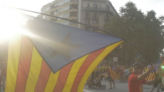 catalan separatist independence demonstration on september 11, 2017 in barcelona city with people celebrating national day of catalonia singing, playing, flags, castallers, celebration in the street - spanish culture stock videos & royalty-free footage