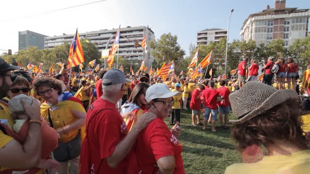 catalan separatist independence demonstration on september 11, 2017 in barcelona city with people celebrating national day of catalonia singing, playing, flags, castallers, celebration in the street - independence stock videos & royalty-free footage