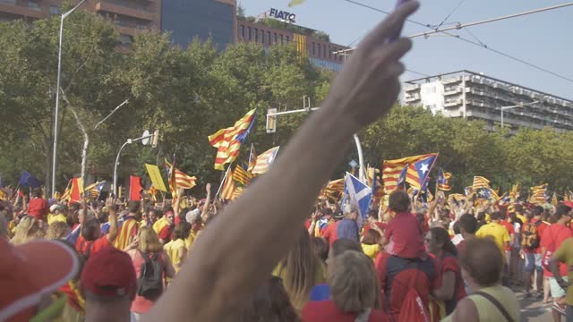 catalan separatist independence demonstration on september 11, 2017 in barcelona city with people celebrating national day of catalonia singing, playing, flags, castallers, celebration in the street - referendum stock videos & royalty-free footage