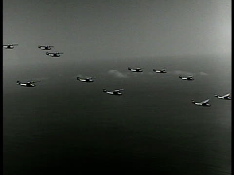 stockvideo's en b-roll-footage met catalina 'flying boat' airplanes flying flying over sea waters world war ii - 1942