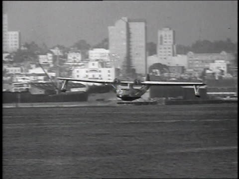 1939 ms pby catalina flying boat taking off from navy yard / san diego, california, united states - 1939 stock-videos und b-roll-filmmaterial