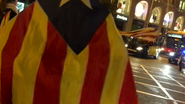 Catalonia independence supporters blocking traffic in Barcelona after arrests of Catalan ministers