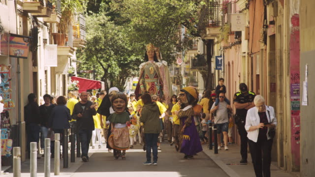 catalonia traditional celebration with gegants and capgrossos cabezudos in a gracia district street - puppet stock videos & royalty-free footage