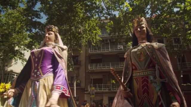 catalonia traditional celebration with gegants giant puppets at a barcelona gracia district square with a church - puppet stock videos & royalty-free footage
