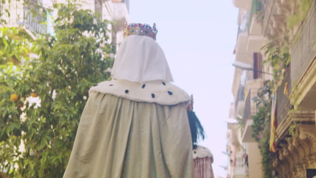 catalonia traditional celebration with gegants giant puppets at a barcelona gracia district street - papier stock videos & royalty-free footage