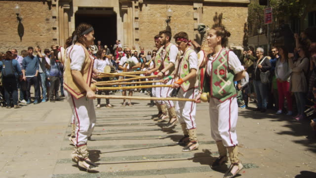 catalonia traditional dancing with poles in barcelona at gracia district square festival - hiking pole stock videos and b-roll footage