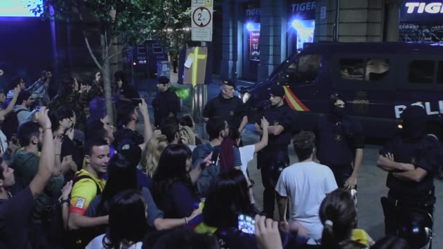 catalonian police officers surround the 'general direction of the national police of spain' offices of the spanish national police as protesters... - obscene gesture stock videos and b-roll footage