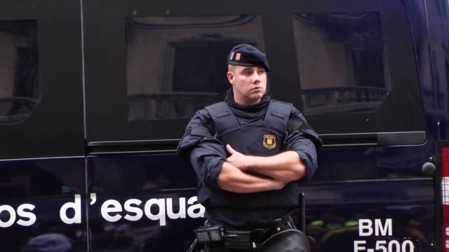 stockvideo's en b-roll-footage met catalonians protest in front of spanish police blocking a spanish police station in central barcelona spain on october 02 2017 as they chant slogans... - 2017