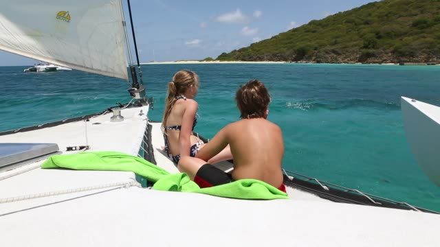 catamaran approaching buck island - bikini bottom stock videos & royalty-free footage