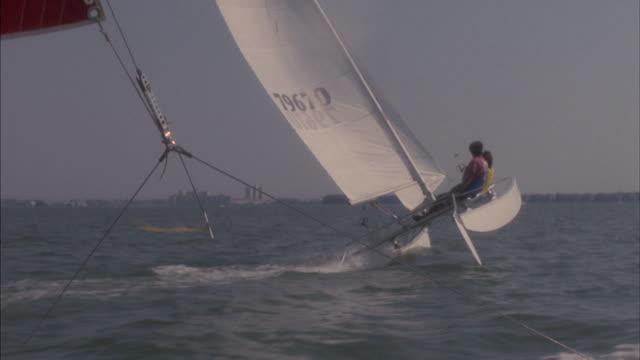 a catamaran capsizes. - misfortune stock videos & royalty-free footage