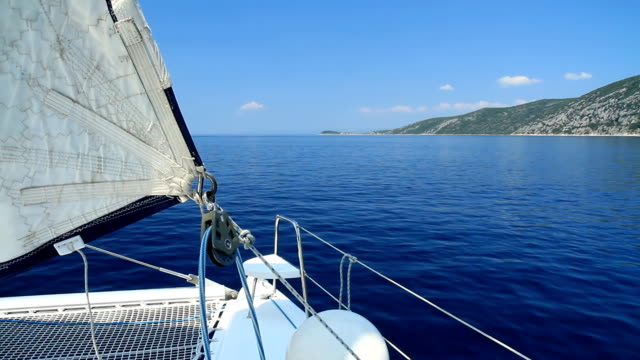 hd: catamaran sailing along the coast - boat point of view stock videos and b-roll footage