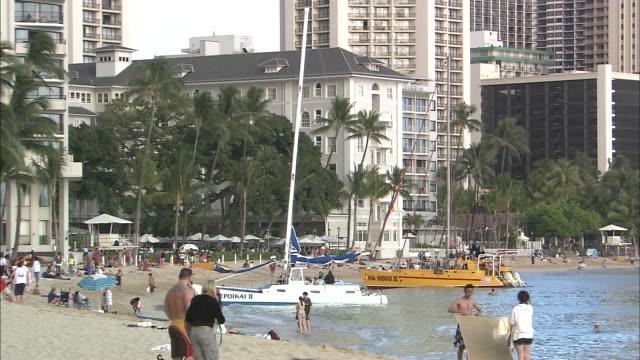 Catamarans float near Waikiki Beach.