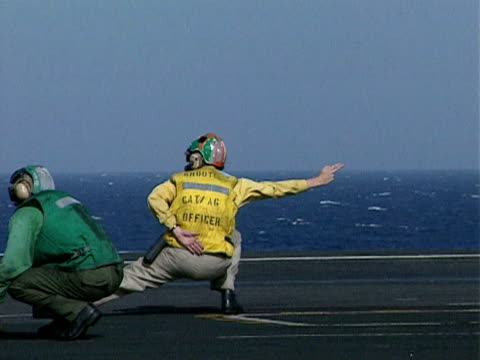a catapult officer directs activities on deck of uss eisenhower using hand signals 1998 - catapult stock videos & royalty-free footage