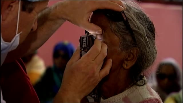 cataract operations project transforming people's lives; india: uttar pradesh: int gv cataract sufferers , who have had an operation, praying to... - doctor who stock videos & royalty-free footage