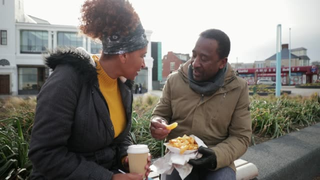 catch up over lunch - street food stock videos & royalty-free footage