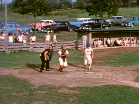 1958 catcher catching ball as batter steps back / catcher throws ball back / little league - bethlehem pennsylvania stock videos & royalty-free footage