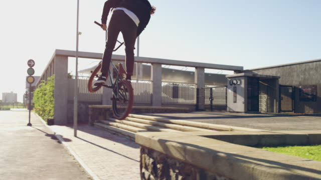 catching a little air - freestyle bmx stock videos and b-roll footage