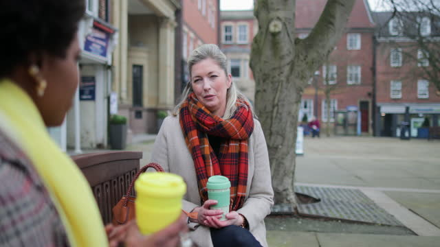 catch-up outdoor s over a hot drink! - town stock-videos und b-roll-filmmaterial