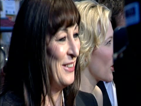 Cate Blanchett is interviewed by press beside Anjelica Huston and Clive Owen on BAFTA red carpet London 12 Feb 05