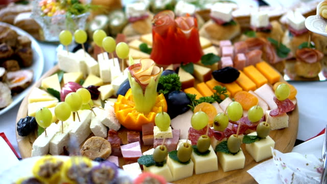 catering buffet style with different light snack - buffet stock videos & royalty-free footage