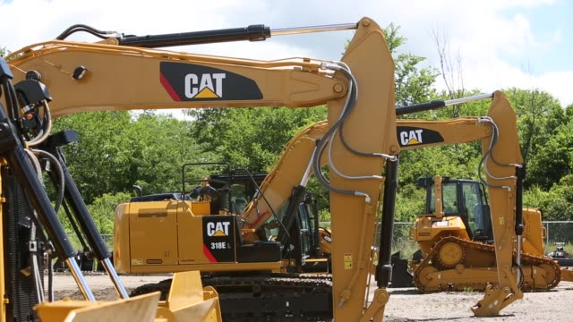 Caterpillar construction equipment sits in rows in a lot at the Altorfer Cat dealership in East Peoria Illinois on July 21 2015 Shots A line of...