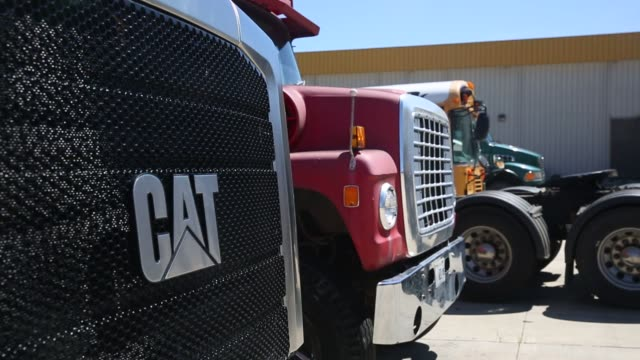 Caterpillar construction equipment sits in rows in a lot at the Altorfer Cat dealership in East Peoria Illinois on July 21 2015 Shots A Caterpillar...