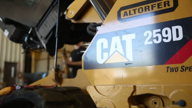 caterpillar construction equipment sits in rows in a lot at the altorfer cat dealership in east peoria illinois on july 21 2015 shots a mechanic... - caterpillar track stock videos and b-roll footage