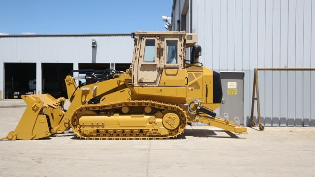 Caterpillar construction equipment sits in rows in a lot at the Altorfer Cat dealership in East Peoria Illinois on July 21 2015 Shots Unpainted...