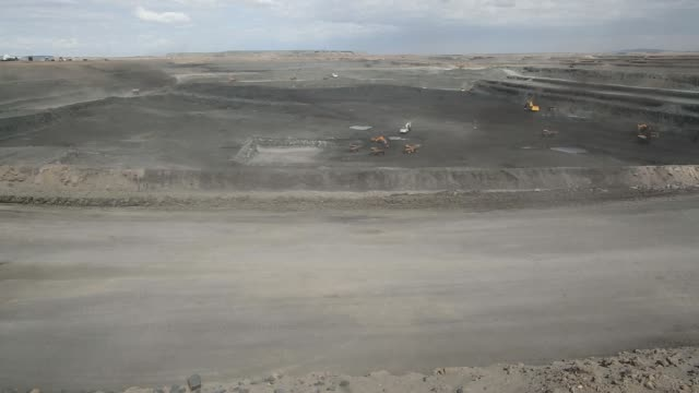 a caterpillar inc dump truck transports a load of coal at the tavan tolgoi coal deposit developed by erdenes tavan tolgoi llc in tsogttsetsii... - caterpillar inc video stock e b–roll