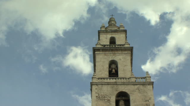 ms la cathedral bell tower against sky / merida, yucatan, mexico - bell tower tower stock videos and b-roll footage