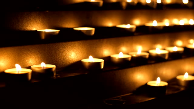 cathedral candles - votive candle stock videos and b-roll footage