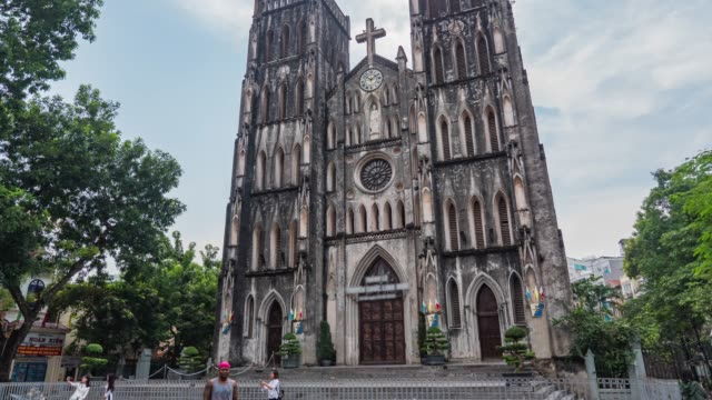cathedral church of st. joseph in hanoi with tourisms, time lapse video - french culture stock videos & royalty-free footage