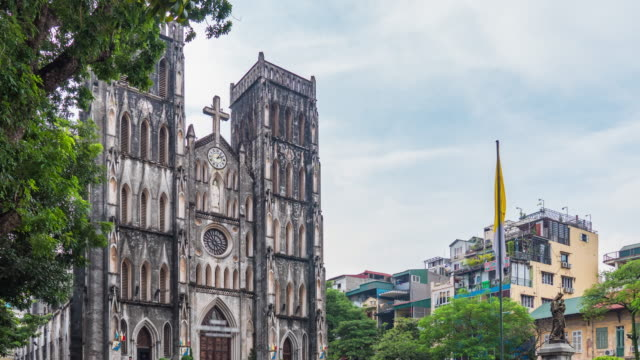 cathedral church of st. joseph in hanoi with tourisms, time lapse video - catholicism stock videos & royalty-free footage
